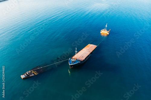 Photo Stands Shipwreck Aerial view of sunken ship near seaside. Shipwreck vessel, drone shot