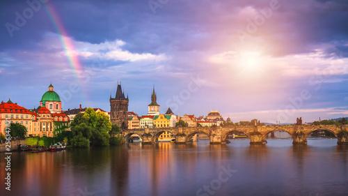 Fotografija  Rainbow over Charles Bridge after a storm in the summer, Prague, Czech Republic