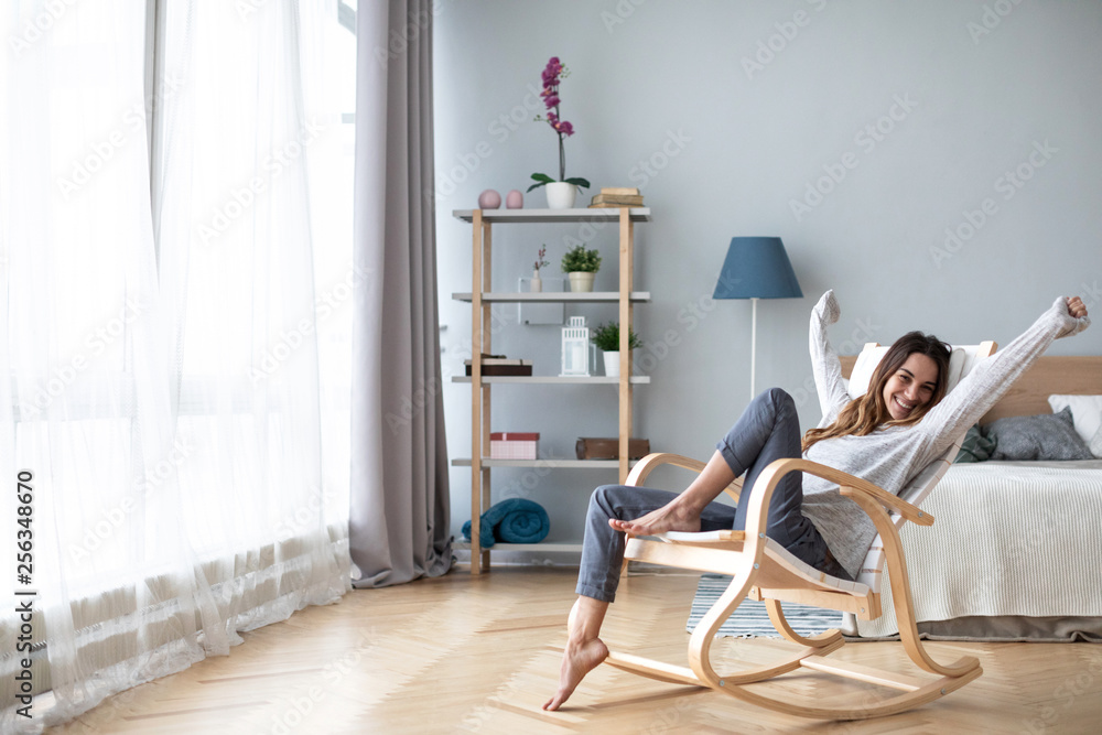 Fototapety, obrazy: Happy young woman relaxing at home.