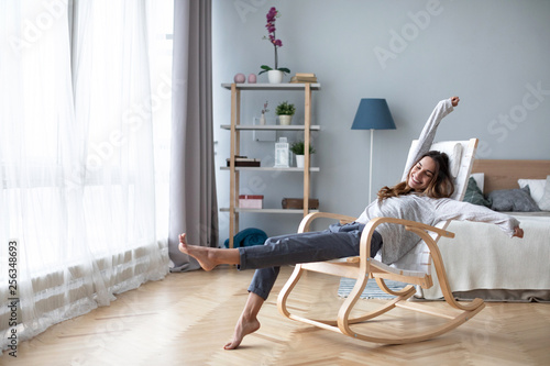 Poster de jardin Detente Full-length body gorgeous good-looking attractive pretty lady with her beaming smile she stretch oneself indoor cosy modern room.