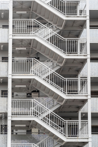 Fire escape stairs outside the building Fototapeta