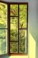 View To Green Garden Through Vintage Wooden Window