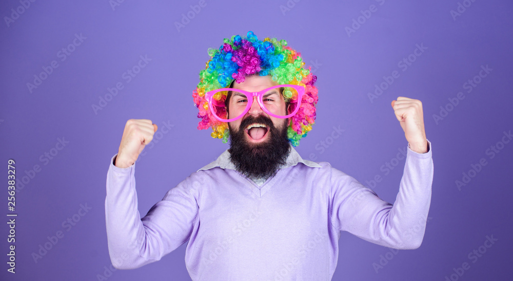 Fototapeta Feel free to express yourself. Having fun. Holiday fun and carnival concept. Man bearded wear colorful wig and funny glasses on violet background. Clown and circus. Party fun. Enjoy being crazy