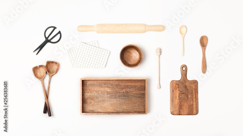 Valokuva  Wooden kitchen utensils on white background. Flat lay, top view.