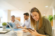 Female startup team member working in office