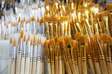 Many Brushes For Painting In The Art Store On The Shelf. Close-up