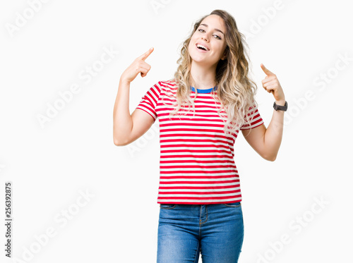 Fototapeta Beautiful young blonde woman over isolated background Smiling pointing to head with both hands finger, great idea or thought, good memory obraz na płótnie