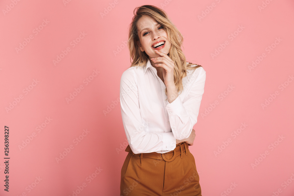 Photo  Portrait of cheerful blond woman 30s in stylish outfit smiling and looking at ca