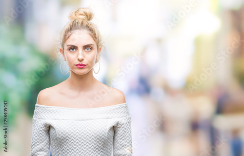 Obraz Young beautiful blonde and blue eyes woman over isolated background with serious expression on face. Simple and natural looking at the camera. - fototapety do salonu