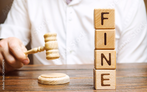 Obraz Wooden blocks with the word Fine and judge. Penalty as a punishment for a crime and offense. Financial punishment. Violations of traffic laws. Fraud. Fines can also be used as a form of tax - fototapety do salonu