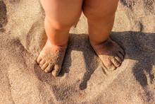 Baby Feet Walking On Sand Beach In The Summer.