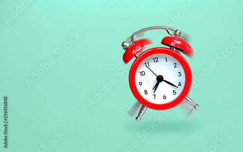 Ringing and bouncing red alarm clock background Wallpaper Mural