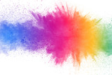 Fototapeta Rainbow - Colorful powder explosion on white background. Abstract pastel color dust particles splash.