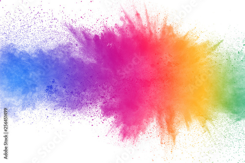 Fototapeta Colorful powder explosion on white background. Abstract pastel color dust particles splash. obraz
