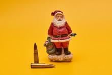 Concept New Year Crime. Santa And Bullets