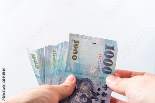 A hand holding a 1000 New Taiwan Dollar bill  - Buy this