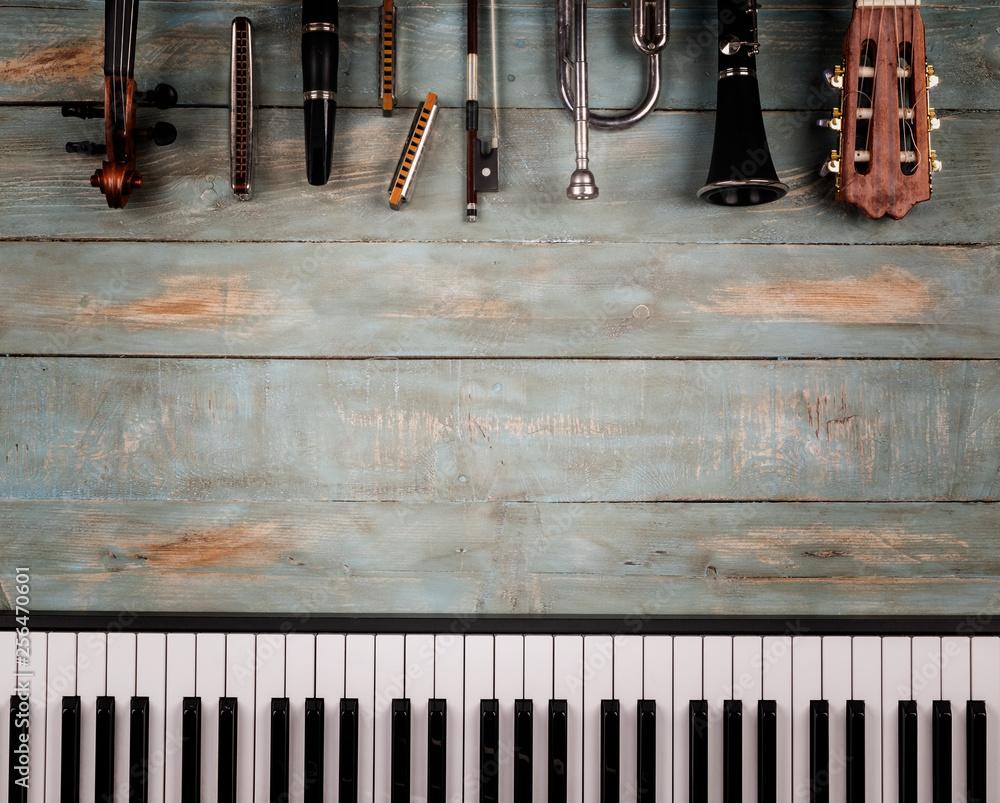 Fototapeta musical instruments in wooden background