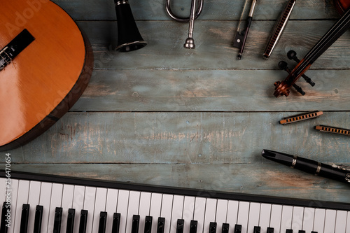 musical instruments in wooden background - 256470654