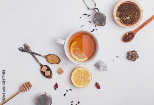 Fotografie, Obraz  Creative composition witn variety of tea, sugar, lemon and other accessories for