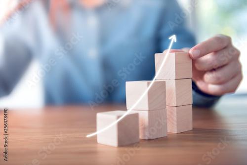 Carta da parati  Hand arranging wood cube stacking as step stair