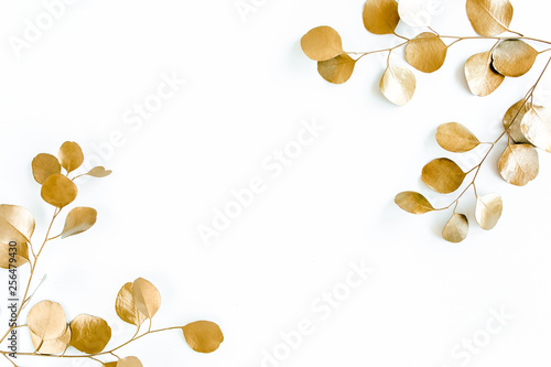Borders of the frame of gold branches, eucalyptus leaves on a white background. flat layout, top view - 256479430