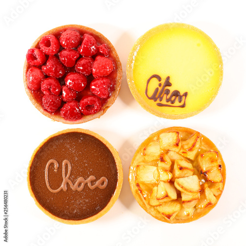 Photo  different sort of pastry, chocolate, raspberry, lemon and apple pie
