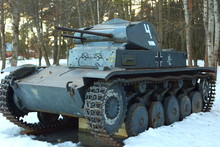 SNEGIRI SETTLEMENT, ISTRA DISTRICT, MOSCOW REGION, RUSSIA MARCH 20, 2019. German Battle Tank 11th Panzer Division In 2nd World War Tiger 2, Panzerkampfwagen II In The Snow Under The Trees.