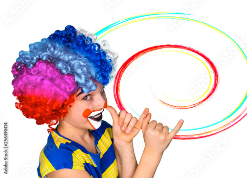 Keuken foto achterwand Carnaval Little cute Boy in wig and painted face jokingly shows his long nose with his fingers palm. Isolated on white. In profile.