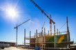 Panorama of the construction site. Construction crane. Construction of the building. Pouring cement. Walling.