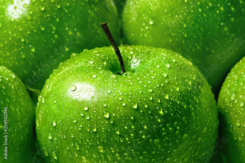 green apple with water drops close-up macro, background