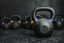 Kettlebells On Dark Backgroud At The Crossfit Gym