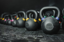 Kettlebells On Dark Backgroud ...