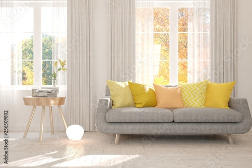 Foto auf Leinwand Orange White stylish minimalist room with sofa and autumn landscape in window. Scandinavian interior design. 3D illustration