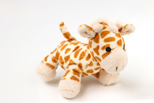Little Giraffe Plushie Isolated On White Background With Shadow Reflection