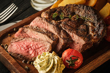 Juicy Steak With Fragrant Butter. Sliced Ribeye Steak With Potatoes, Onions And Baked Cherry Tomatoes