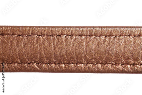 Fotografía  Brown leather belt strap closeup isolated on white.