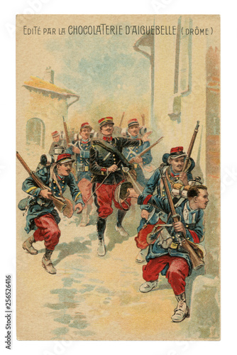 French historical advertising chromolithographic postcard: officer leads a soldier infantry with rifles through the streets of the enemy city, street battle, world war one 1914-1918 Canvas Print
