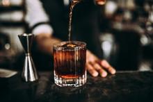 A Close Up Shot Of A Bartender...