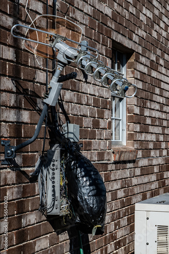 Fotografie, Tablou  Digital TV antenna mounted on brick building