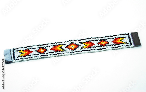 Fotografie, Obraz Native American beaded bracelet  Red, orange, yellow and black on White Beads