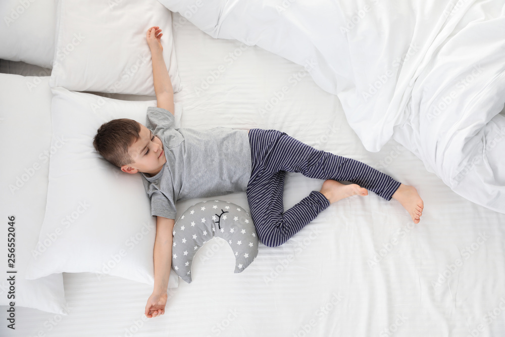 Fototapety, obrazy: Cute little boy with toy sleeping on bed, above view