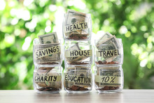Glass Jars With Money For Diff...