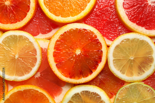 Keuken foto achterwand Plakjes fruit Slices of fresh citrus fruits as background, top view