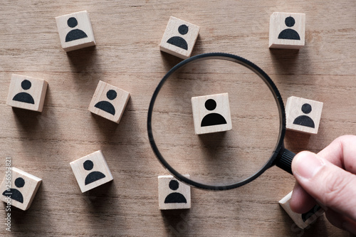 Photo Searching for talent or looking for employee concept using magnifying glass