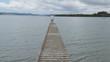 wide shot of a bridge, lake, river & beach
