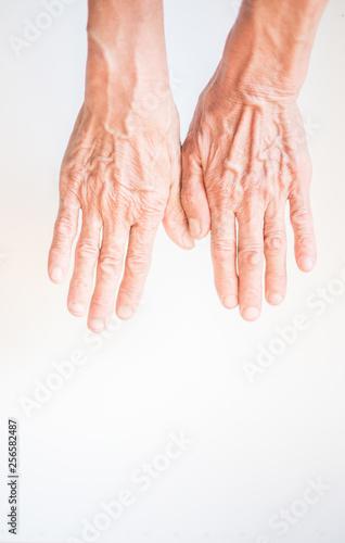 Fotografia, Obraz  Both hands of the elderly on a white background