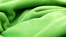 Texture Of Green Fleece Fabric. Soft To The Touch Fabric, Pleasant To The Skin