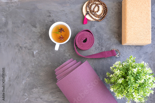 Obraz Rolled yoga mat with mala beads and Ayurveda tea for relax yoga practice y meditation. - fototapety do salonu