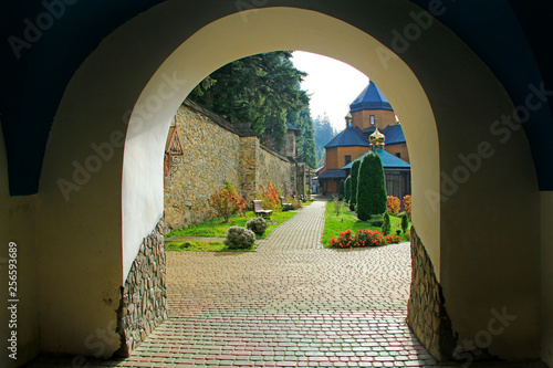 Poster de jardin Con. Antique Beautiful view from arch in Manyava Skete. Spiritual place in Western Ukraine