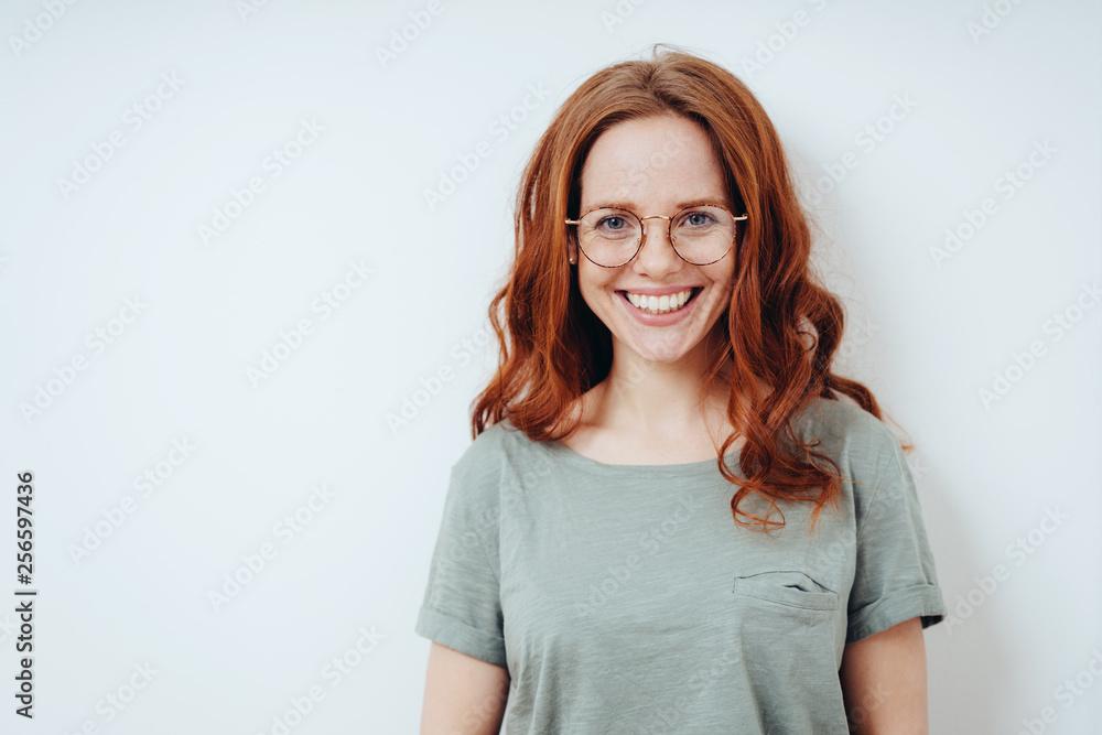 Fototapeta Happy vivacious young redhead woman